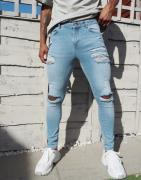 ASOS DESIGN spray on 'vintage look' jeans with power stretch in light ...